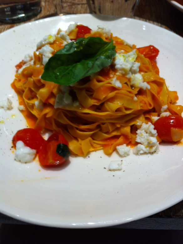 Fresh pasta with tomato, basil and mozzarella
