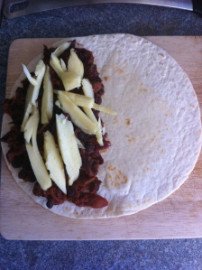 fill half the tortilla wrap and top with lots of cheese