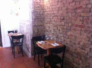 the small tables nestled at the back of the restaurant