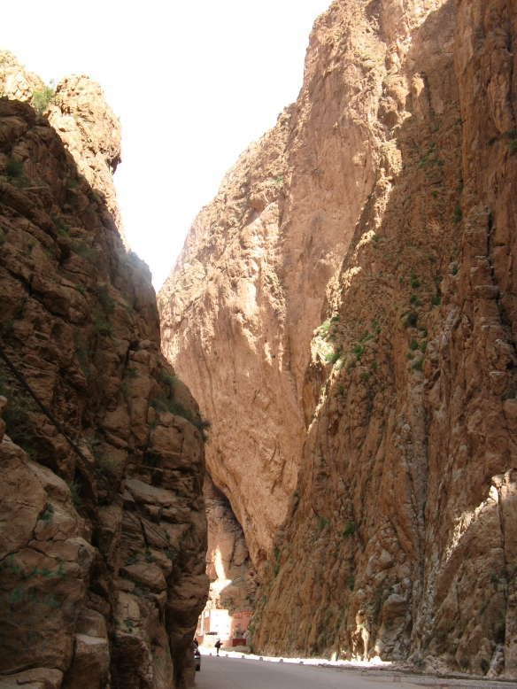 Walking inside Todra Gorge. Walking through the gorge it is beautiful. The colours changing with the sun, the walls towering above you. It just highlights the many faces of Morocco.